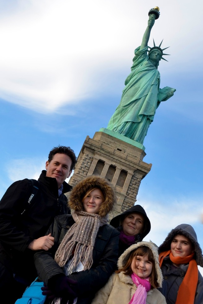 Our family in front of the the Statue of Liberty.